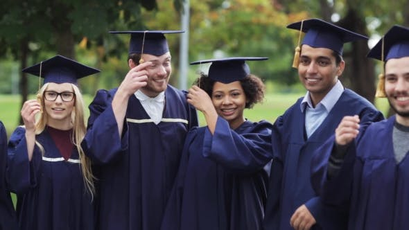 Thumbnail for Happy Students In Mortar Boards With Diplomas 73