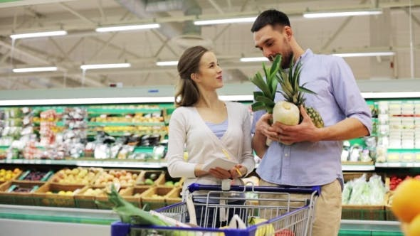Thumbnail for Couple With Food In Shopping Cart At Grocery Store 15