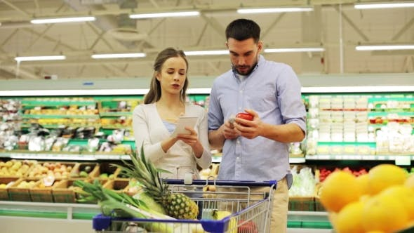 Thumbnail for Couple With Food In Shopping Cart At Grocery Store 16