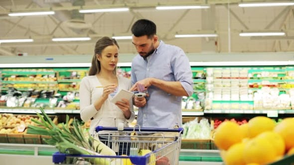 Thumbnail for Couple With Food In Shopping Cart At Grocery Store 17