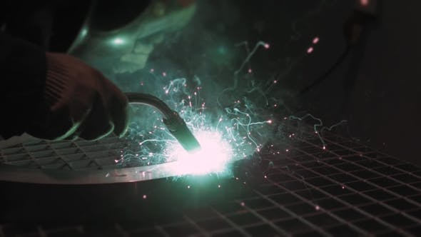 Thumbnail for Welder Industrial Automotive Part In Factory, Hot Metal Welding On Modern Workshop With Sparkles