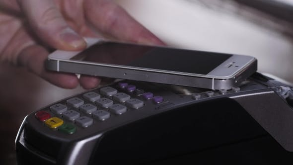 Thumbnail for Customer Paying With NFC Technology By Mobile Phone On Terminal In Modern Cafe