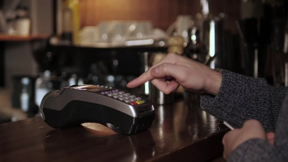 Thumbnail for Hands With Credit Card Reader At Modern Cafe