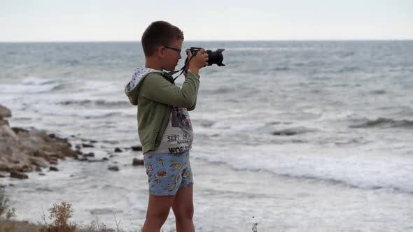 Thumbnail for Beach Summer Vacation. Boy on the Beach with a Camera