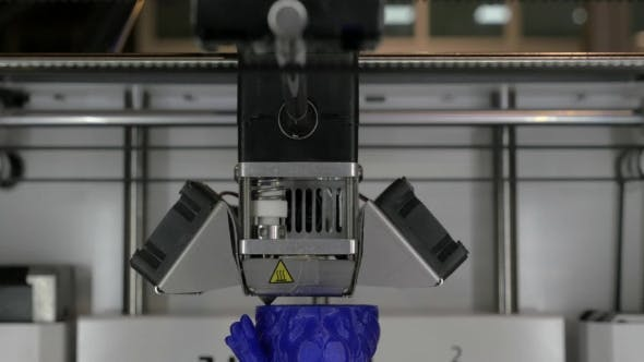 View Of Printing Plastic Model On a 3D Printer In Process.