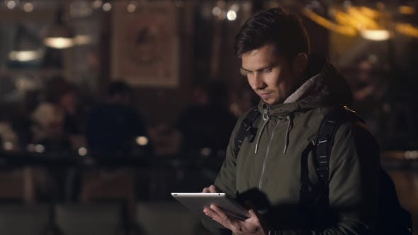 Thumbnail for Handsome Young Man With Tablet Pc Navigating In The Night Streets