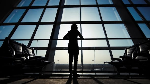 Thumbnail for Silhouette Of a Man Traveler With Backpack. Business And Travel
