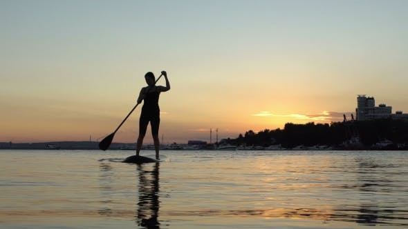 Cover Image for Beautiful Woman On Stand Up Paddle Board. SUP.