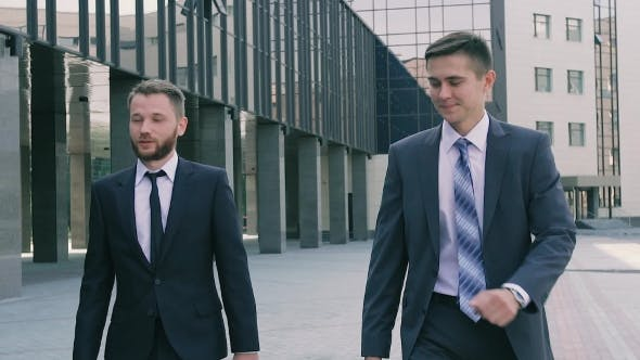 Thumbnail for Two Business Men Wearing Smart Clothes And Holding Leather Cases Walking