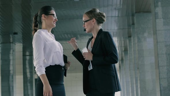 Thumbnail for Two Friendly Business Women Talking Happily Taking Time Off The Work