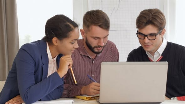 Thumbnail for Creative Team Of Two Men And One Woman Sitting At The Office