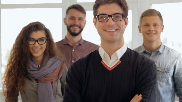 Thumbnail for Three Men And One Woman Pose At The Office