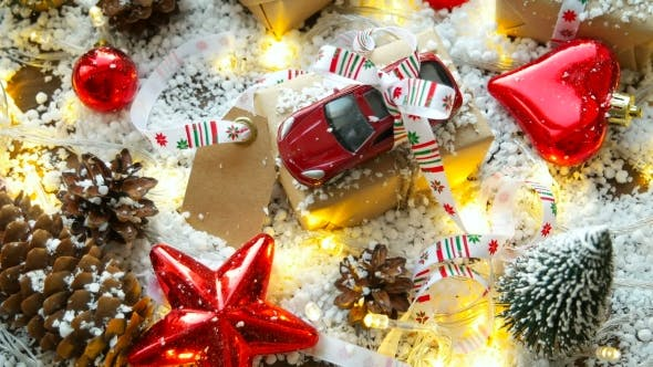 Thumbnail for Christmas And New Year Background With Toy Car, Presents, Ribbons, Balls And Different Green