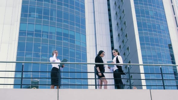 Thumbnail for Three Attractive Business Women Are Waiting For Their Coworkers On Terrace