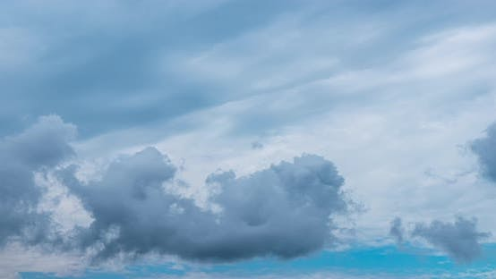 Picturesque Clouds Float in Blue Sky on Windy Day
