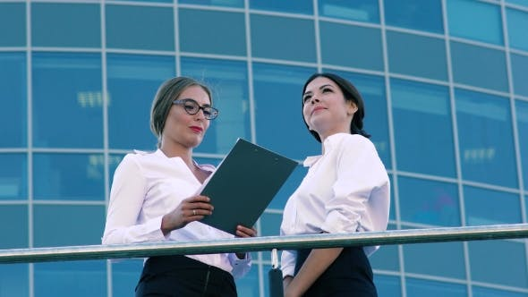 Thumbnail for Portrait Of Young Business Women Talking About Their Business