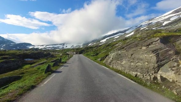 Driving a Car On a Road In Norway