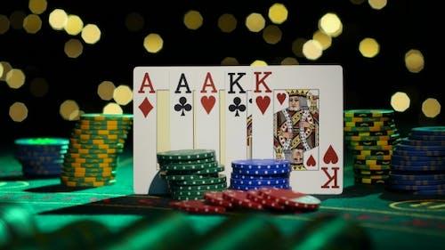 Full House Poker Game On Gamblimg Table.