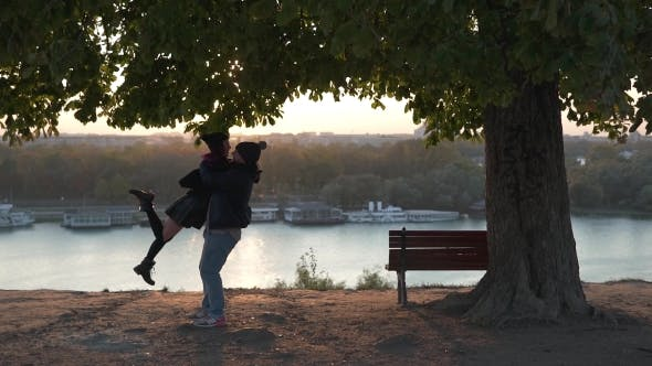 Thumbnail for Man Hugging a Girl In The Sunlight