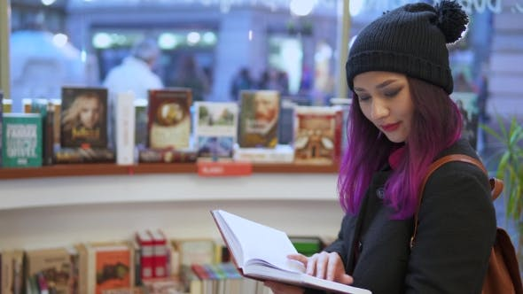 Thumbnail for Young Girl Reads Book In Supermarket