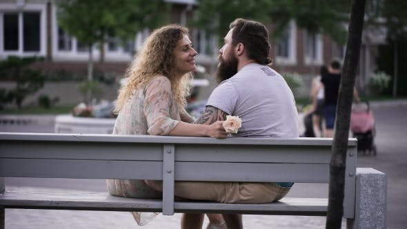 Thumbnail for Married Couple In The Park On a White Bench.