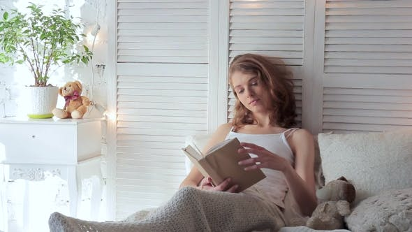Thumbnail for Woman Lying In Bed While Reading a Book In Morning