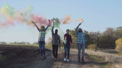 Youth With Colored Smoke Grenades