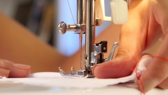 Thumbnail for Sewing Machine, The Needle Pierces The Fabric.