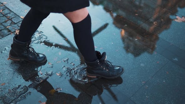 Thumbnail for Woman Crosses Wet Street With Large Pool