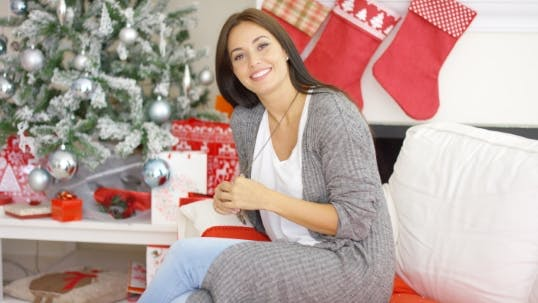 Cover Image for Friendly Young Woman Relaxing At Home At Christmas