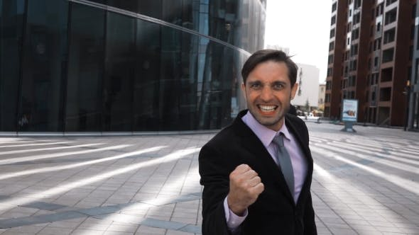 Thumbnail for Businessman Happy Of Winning Deal With Fist Shaking