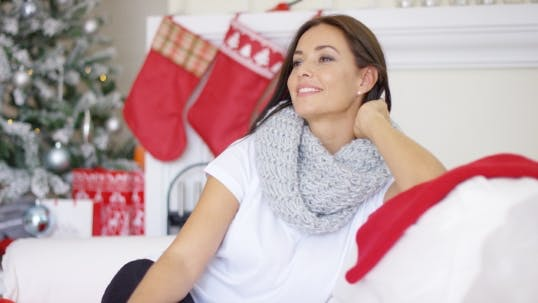 Thumbnail for Pretty Young Woman Sitting Dreaming Of Christmas