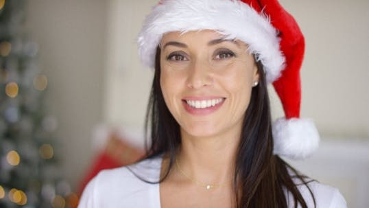 Thumbnail for Pretty Vivacious Woman Donning a Santa Hat