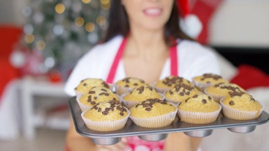 Thumbnail for Young Woman With a Tray Of Christmas Cupcakes