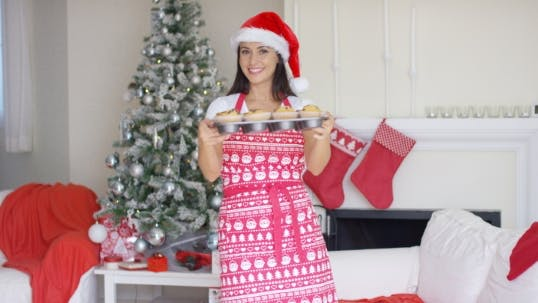 Thumbnail for Attractive Christmas Cook Showing Off Her Cupcakes