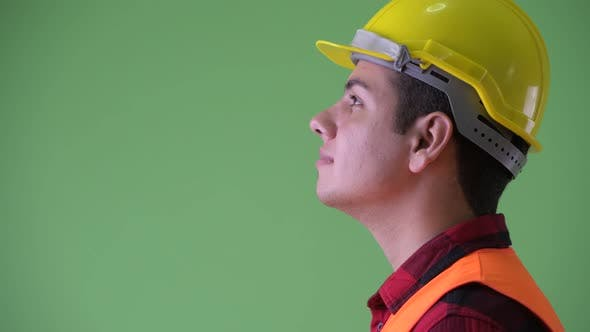 Thumbnail for Closeup Profile View of Happy Young Multi Ethnic Man Construction Worker Smiling