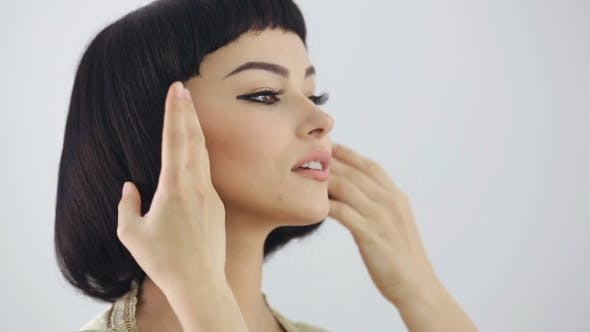 Thumbnail for Hairstyle Preparations. Cleopatra's Make-up And Haircut Posing In Studio