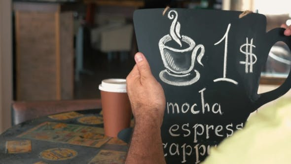 Thumbnail for Man Writing Coffee Price On Chalk Board