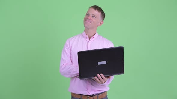 Thumbnail for Happy Businessman Thinking While Using Laptop