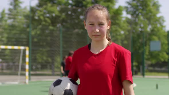 Thumbnail for Young Soccer Girl Holding Ball and Posing for Camera