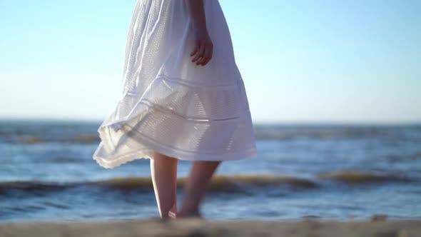 Thumbnail for Pretty Woman Walks at Seaside Surf