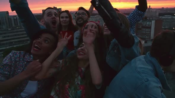 Thumbnail for Ecstatic Friends Taking Selfie on Rooftop
