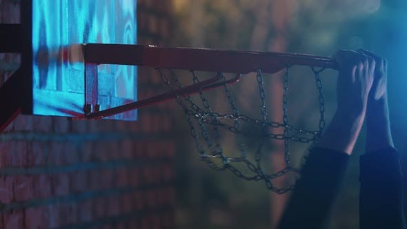 Thumbnail for Basketball Ball Getting in the Hoop on Outdoor Playground at Night - Slam Dunk