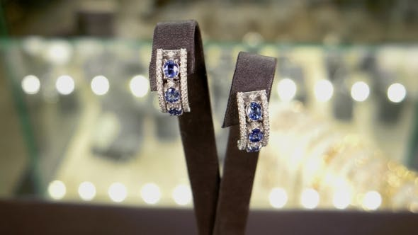 Thumbnail for Jewelry, Women Earrings In Gold With Blue Gems Earrings With Diamonds On In Storefront At a Jewelry