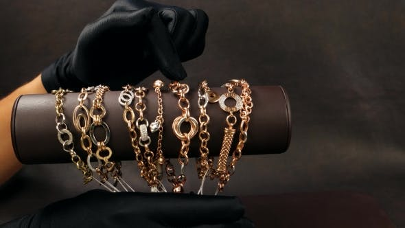 Thumbnail for Jewelry In The Store, Sold In Black Gloves Shows Gold Jewelry In The Store, a Lot Of Gold Bracelets