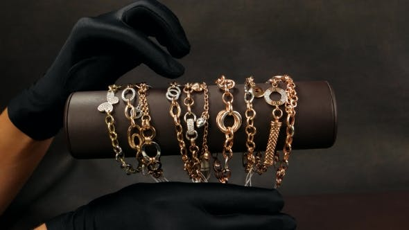 Thumbnail for Jewelry In The Store Seller Indicates The Buyer Jewelery, Bangles Of Yellow And White Gold