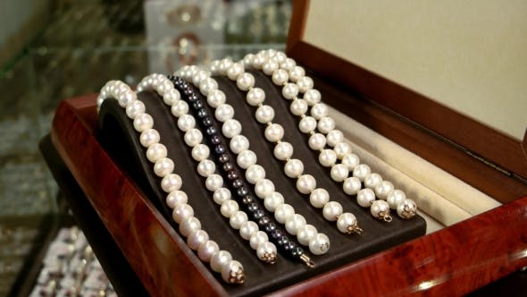 Cover Image for Jewelry Made Of Pearls On a Beautiful Stand