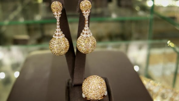 Cover Image for Expensive Jewelry For The Rich And Famous Women On The Counter, Earring, Ring, Pendant, Gold