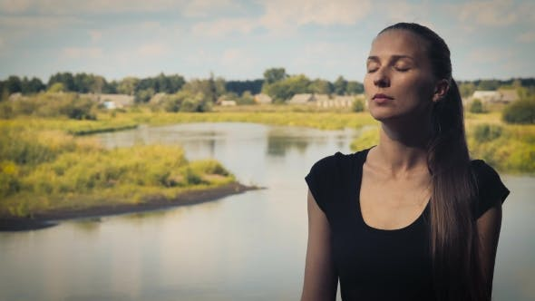 Thumbnail for Portrait Of a Young Woman Who Meditates On a Background Of Nature With Eyes Closed