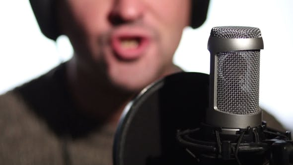 Thumbnail for Man Singing Into a Condenser Microphone.